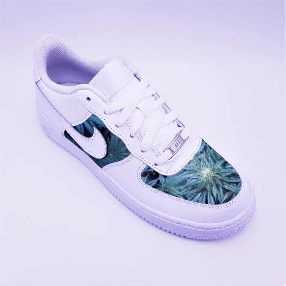 Customized Nike Air Force 1 in Weed mode. A pair of custom nike air force with cannabis leaves by ATPIK custom sneakers.